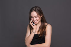 Smiling beautiful woman talking on phone royalty free stock images