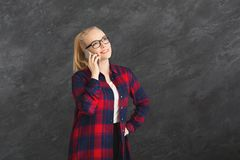 Smiling beautiful woman talking on phone stock photography