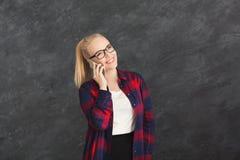 Smiling beautiful woman talking on phone royalty free stock image