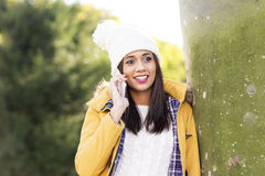 Smiling beautiful woman talking by phone, winter lifestyle conce Stock Image