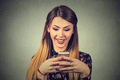 Smiling beautiful woman texting on her mobile phone Stock Image
