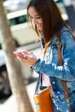 Smiling beautiful woman texting with her phone Royalty Free Stock Photos