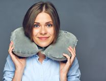 Smiling beautiful woman with travel pillow on neck. Isolated portrait Royalty Free Stock Images