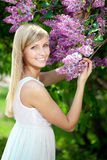 Smiling beautiful woman with violet flowers Stock Photography
