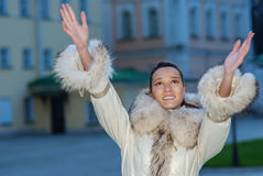 Smiling beautiful woman in white coat Stock Images