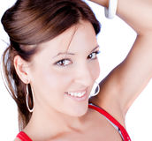 Smiling beautiful woman with white earrings Stock Photography