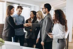 Smiling beautiful woman shaking male hand, greeting handshake of female applicant arriving at job interview, businesswoman making royalty free stock photography