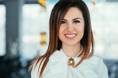 Smiling beautiful young business lady delight. Smiling young business lady portrait. Beautiful successful female looking at camera. Prosperity contentment royalty free stock image