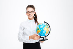 Smiling beautiful young busineswoman in glasses standing and holding globe. Over white background Stock Images