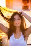 Smiling beautiful young woman portrait enjoy in sunset summer royalty free stock image