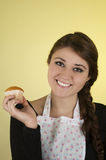 Smiling beautiful young hispanic brunette baker Stock Photography