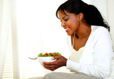 Smiling beautiful young lady holding a salad Stock Photography
