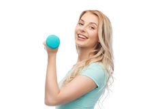 Smiling beautiful young sporty woman with dumbbell Royalty Free Stock Images