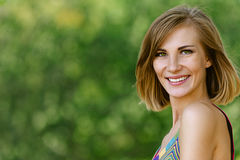 Smiling beautiful young woman close Royalty Free Stock Image
