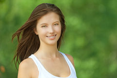 Smiling beautiful young woman close Royalty Free Stock Photo