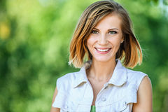 Smiling beautiful young woman close-up Stock Photos