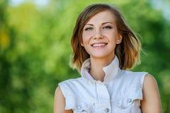 Smiling beautiful young woman close-up Stock Image