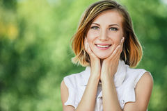 Smiling beautiful young woman close-up Royalty Free Stock Images