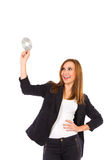 Smiling beautiful young woman holding compact disc. Stock Images