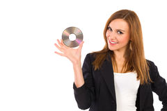 Smiling beautiful young woman holding DVD. Stock Photo
