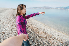 Smiling beautiful young woman holding hand her boyfriend Royalty Free Stock Image