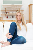 Smiling beautiful young woman in jeans Stock Image