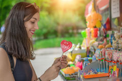 Smiling beautiful young woman with lollipops Stock Photo