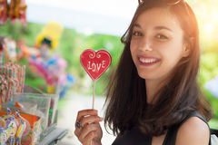 Smiling beautiful young woman with lollipops Royalty Free Stock Photo