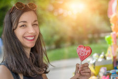 Smiling beautiful young woman with lollipops Royalty Free Stock Image
