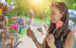 Smiling beautiful young woman with lollipops Royalty Free Stock Photos