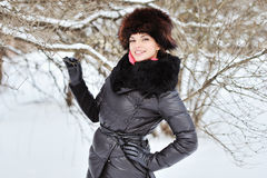 Smiling beautiful young woman. Outdoor in a winter day Royalty Free Stock Images