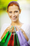 Smiling beautiful young woman with shopping Royalty Free Stock Photography