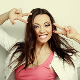 Smiling beautiful young woman showing thumbs up gesture Stock Photo