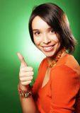Smiling beautiful young woman showing thumbs up gesture Stock Photos