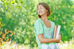 Smiling beautiful young woman-student with books Royalty Free Stock Image
