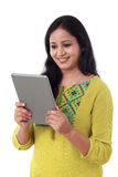 Smiling beautiful young woman with tablet computer Royalty Free Stock Image