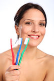 Smiling beautiful young woman with toothbrushes Royalty Free Stock Images