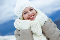 Smiling beautiful young woman in winter time. Stock Photos