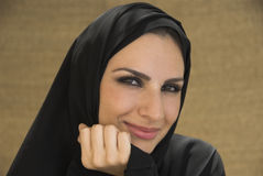 Smiling Beauty. A lovely muslim woman smiling at the camera Royalty Free Stock Image