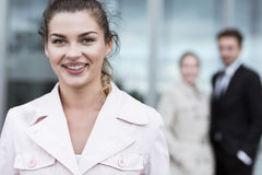 Smiling beauty businesswoman. Standing in front of office stock photography