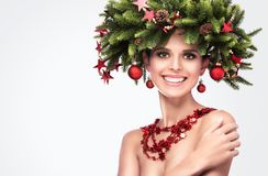 Smiling Beauty Fashion Model Girl with Fir Branches Decoration I royalty free stock image