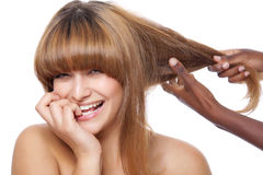 Smiling beauty getting her hair done Stock Photography