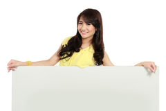 Smiling beauty girl holding blank white board Royalty Free Stock Photos