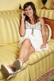 Smiling Beauty Girl on Sofa Stock Photos