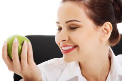 Smiling beauty holding green apple Royalty Free Stock Images