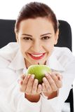 Smiling beauty holding green apple Royalty Free Stock Photos