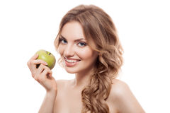Smiling beauty holding green apple while isolated Royalty Free Stock Images
