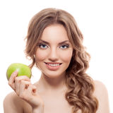 Smiling beauty holding green apple while isolated Stock Photography
