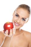 Smiling beauty holding red apple Stock Photos
