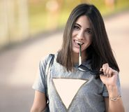 Beautiful girl with her sunglasses in her hand stock images